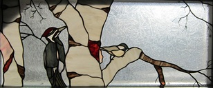 stained glass birds pileated woodpecker and chickadee