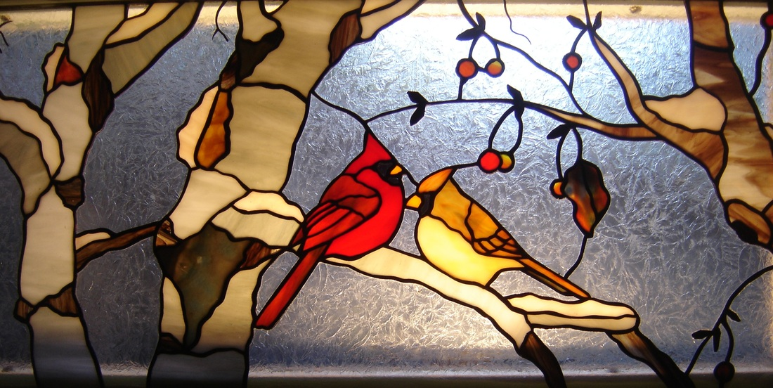 Stained glass birds cardinal