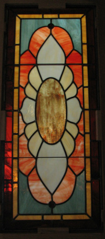 Original stained glass bird design by Tom Nelson