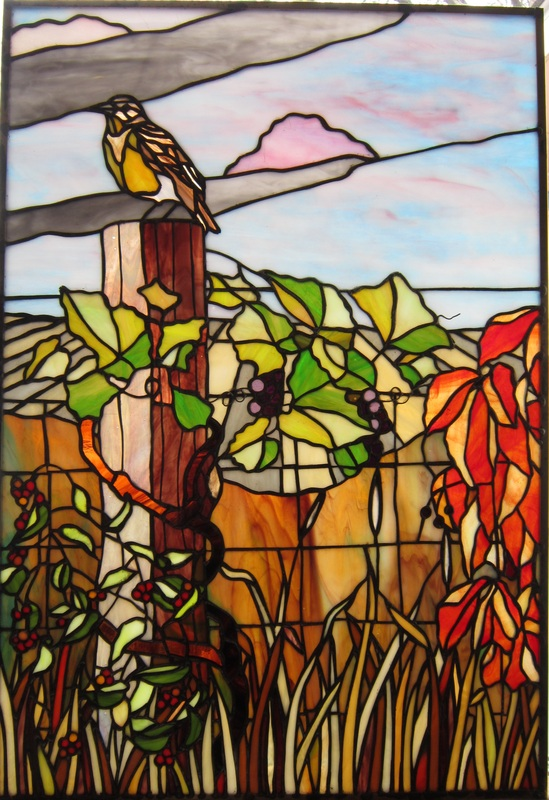 Stained glass meadow lark and vines birds