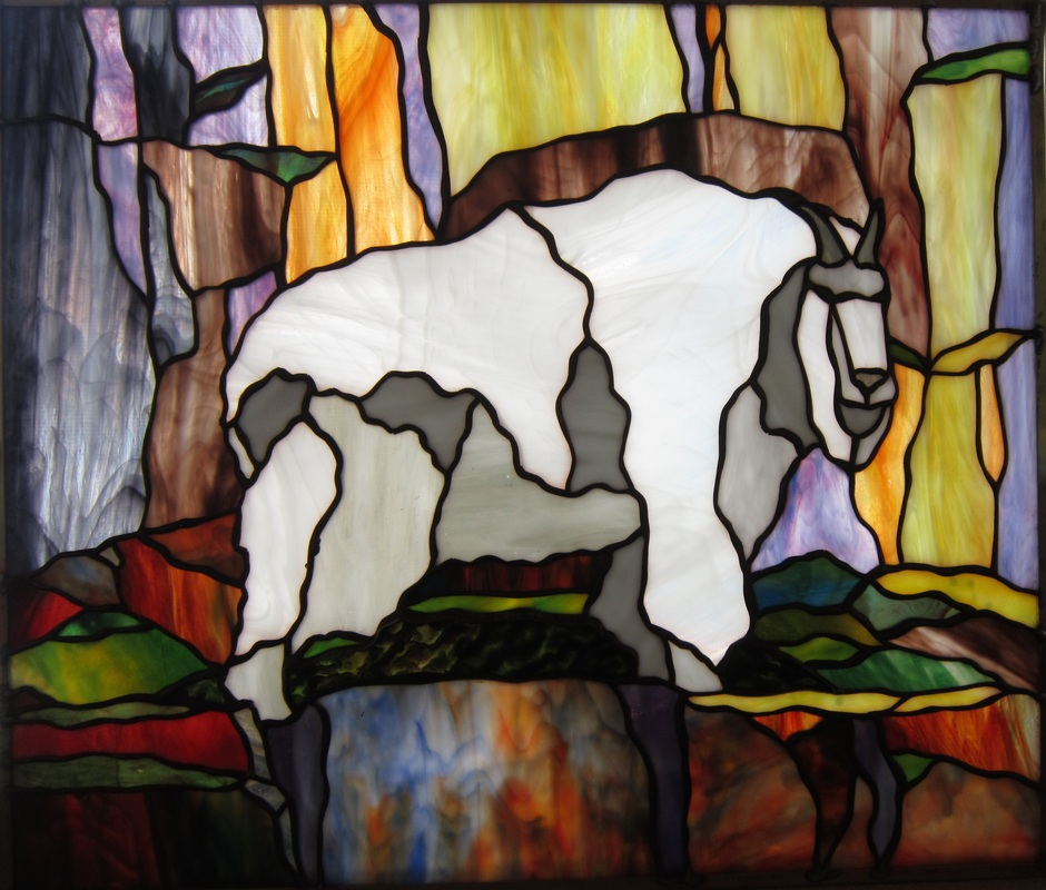 Stained glass mountain goat by spectrum stained glass studio