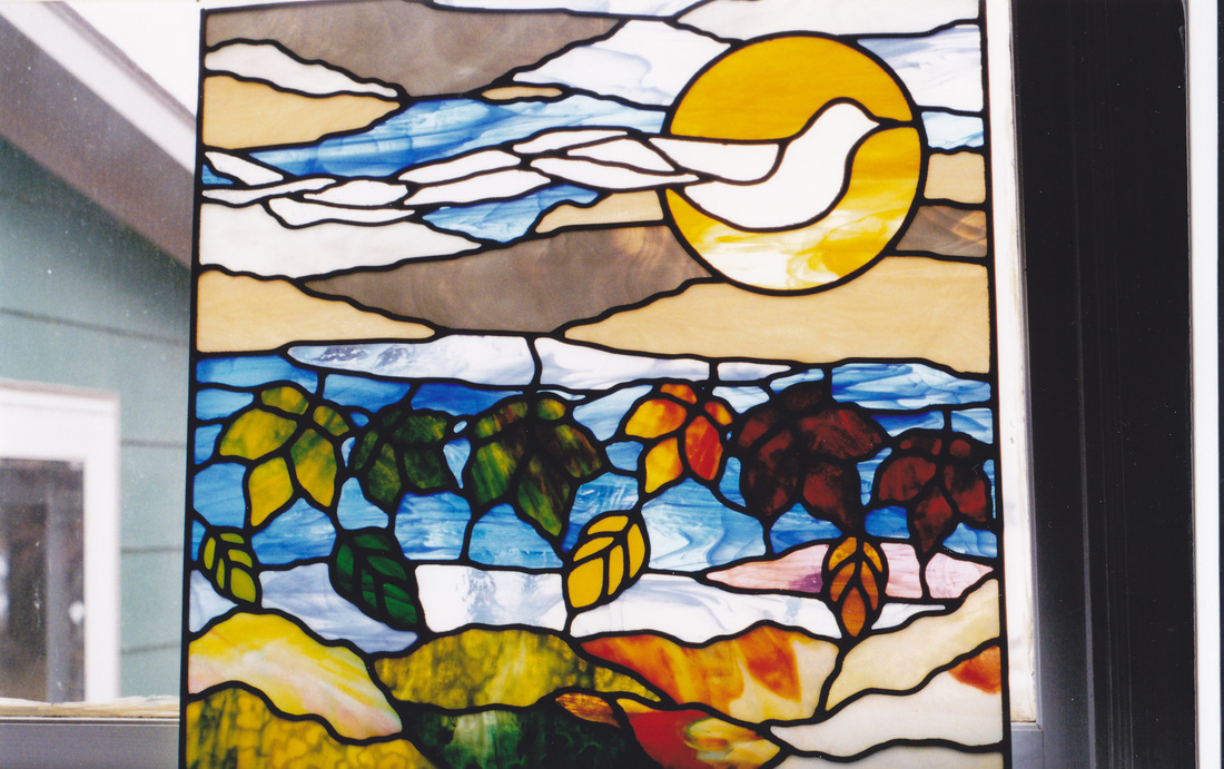 foiur seasons dove window in stained glass