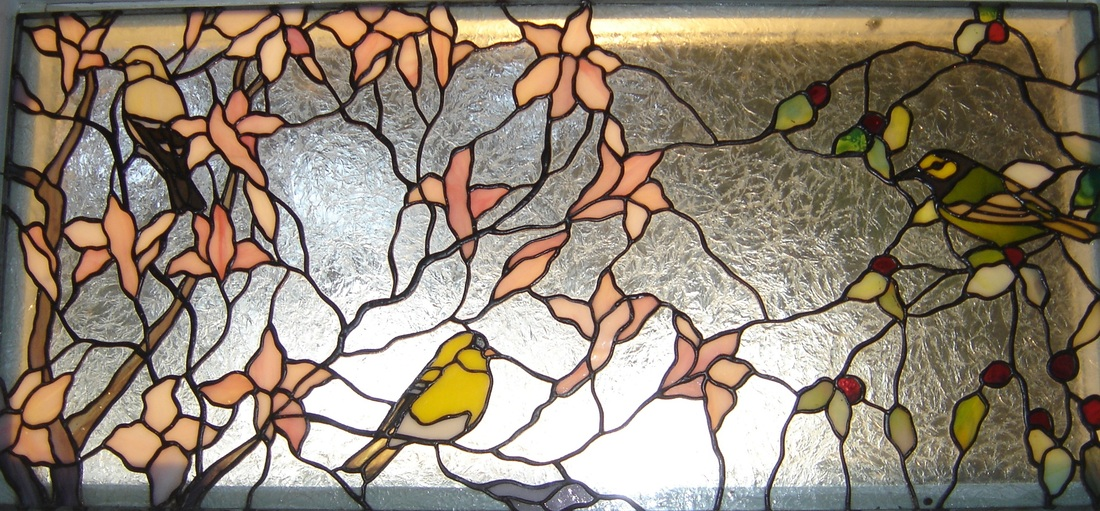 stained glass birds gold finches and hooded warbler