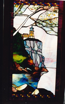 Custom stained glass split rock lighthouse in stained glass