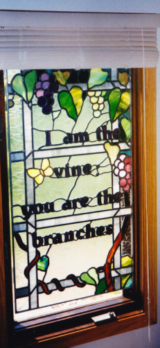 stained glass vine theme window